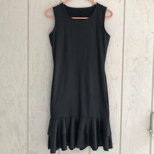 Women's Simple Black Dress with Ruffle Hem.